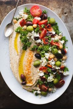 This Loaded Hummus is a great crowd-pleasing appetizer, but the hummus recipe itself is a keeper! Make this regularly and keep a container in the fridge! It's great for snacking, lunches and dinners. Naturally vegan and gluten-free. From healthy food Great Appetizers, Appetizer Recipes, Appetizer Ideas, Wedding Appetizers, Easy Summer Appetizers, Dinner Party Appetizers, Veggie Appetizers, Dinner Parties, Nibbles Ideas