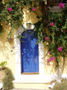 the sunshine makes this blue door so pretty