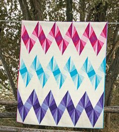 Three chevron stripes zigzag across an eye-catching, throw-size quilt. Foundation piecing makes the spikey patches easy to sew in this modern design.