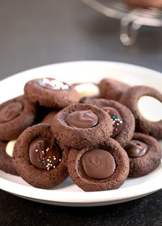 These gluten free chocolate thumbprint cookies have a soft brownie-like texture and rich chocolate flavor. Perfect for any cookie plate! - May 05 2019 at Gluten Free Sweets, Gluten Free Cookies, Gluten Free Baking, Dairy Free Recipes, Baking Recipes, Cookie Recipes, Dessert Recipes, Gluten Free Christmas Cookies, Baking Ideas