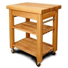 The Catskill Country Kitchen Cart with Butcher Block Top is an excellent storage addition to your kitchen. The kitchen cart contains a butcher top, two slatted shelves, and a spacious d