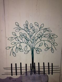 Tree and border maxed from recycled metal wire welded together Tools is very simple to form the metal  It can be better also with nice paint or just stay clean metal