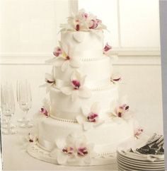 Elegant beach wedding cake with falling orchids...