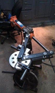 Tubing Bender by DMoneyAllstar -- Homemade tubing bender based on a JD2 Model 3. Bender is outfitted with SWAG mount and an air/hydraulic cylinder. Custom dies were machined from T6061. http://www.homemadetools.net/homemade-tubing-bender-5