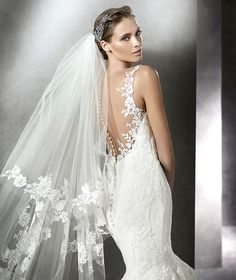 STYLE PHILIPA 2016 PRONOVIAS Tulle, mermaid-style wedding dress with lace and guipure appliqués. V-back bodice with scallops front and back. Sheer plunging back with appliqués and buttons.