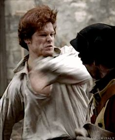 Jamie being a badass and fighting off the Redcoats at Lallybroch.