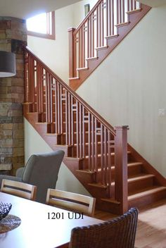 Wooden staircase with custom balusters and box newels