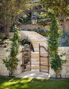 Arbor, wooden gate, and stone steps