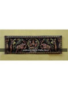 Multicoloured Wooden Wall Panel of Gaja Lakshmi Gajalakshmi is one of the Eight incarnation of Lakshmi (Gayathri Devi).As the name itself shows us that this is related to the Elephant (Gaja). The same way on the both upper sides of the lakshmi the elep Wooden Wall Panels, Wooden Walls, Indian Home Decor, Wood Wall Decor, Wood Carving, Elephant, Decor Ideas, God, Wood Walls
