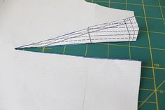 """[Marking dart-leg stitching lines onto your fabric.] QUOTE: """"For the darts I cut into one side of the pattern and folded it open on the other line so I could trace the outline of it to the wrong side of my fabric with chalk."""" UNQUOTE - from the blog: http://luckylucille.com/2012/01/make-it-sorbetto-top/"""
