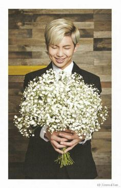 RapMon..in a suit...with flowers...(*_*)