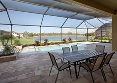 An indoor/outdoor living area by the pool at Bonita Lakes, Florida