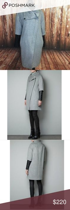 ZARA COAT WITH QUILTED FAUX LEATHER SLEEVES - As seen on many Celebrities, Bloggers and Fashionists!!!-Rare and Super Popular!-Excellent Condition (Sold out everywhere!)- Purchased directly from ZARA (100% Guaranteed Authentic Zara!)- Ref. number: 8008/284- Color: Gray/ Grey- Size: L/ Large *OUTER SHELL:- Main Fabric: 51% Wool, 45% Polyester, 4% Other fibres.- Sleeve base fabric: 100% Polyester.- Sleeve coating: 100% Polyurethane.*LINING:- Main lining: 100%…