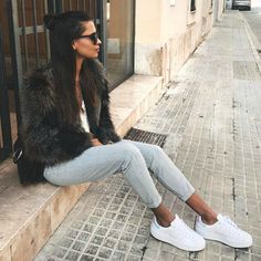 Emelie Natascha Lindmark + short faux fur coat + faded denim skinny jeans + pair of sparkling white sneakers   Brands not specified, Spring outfits.