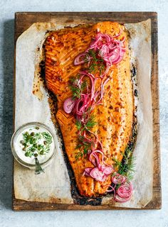 Even non-salmon lovers can't resist this dish at Christmas. Not too oily, glazed in tangy pomegranate molasses and with a side of quick-pickled red onion and herby yoghurt mayo, it's a total winner. Salmon Recipes, Fish Recipes, Seafood Recipes, Cooking Recipes, Healthy Recipes, Roast Salmon Recipe, Red Onion Recipes, Healthy Gourmet, Whole30 Recipes