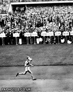 Paavo Nurmi carrying the Olympic torch #greatestrunnerever