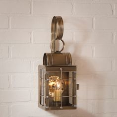 Outdoor lighting which includes post lights, wall sconces and hanging lights. They would work well on a Period, Country, Colonial or a Early American,Double Wall Lantern in Weathered Brass by Irvins Country Tinware. Outdoor Barn Lighting, Outdoor Wall Lantern, Outdoor Wall Sconce, Exterior Lighting, Outdoor Walls, Wall Sconce Lighting, Candle Sconces, Wall Sconces, Indoor Outdoor
