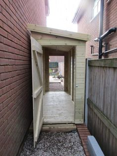 Backyard Storage Sheds, Backyard Sheds, Backyard Garden Design, Small Backyard Landscaping, Shed Storage, Bike Storage Front Garden, Small Garden Design With Shed, Narrow Shed, Narrow Garden