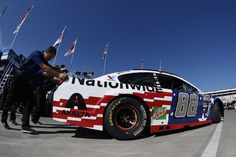 At-track photos: Saturday, Charlotte:    Saturday, May 28, 2016   -    CHARLOTTE, NC - MAY 28: Crew members push the No. 88 Nationwide Chevrolet, driven by Dale Earnhardt Jr., through the garage area during practice for the NASCAR Sprint Cup Series Coca-Cola 600 at Charlotte Motor Speedway on May 28, 2016 in Charlotte, North Carolina.