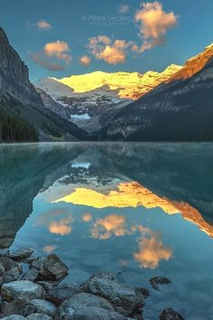 Calm Sunrise at Lake Louise in Banff National Park, Alberta, Canada. (1080x1620) #nature and Science  Canada Photography  Information on our Site  http://storelatina.com/travelling  #traveling #CanadaPhotography #canadatravel  Canada Photography  Information on our Site  http://storelatina.com/travelling #photographyinformation  Canada Photography  For information Få adgang til vores hjemmeside  http://storelatina.com/canada/travelling