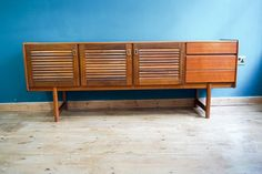 A fantastic vintage sideboard made by A.H.McIntosh & Co Ltd Of Kirkcaldy Scotland.  This is a lovely vintage piece of furniture, it has a great modernist Scandinavian style.   It was made in 1971, the date is still visible on the back to the top right corner.  As you can see from the picture's it is tremendously clean, it has obviously been taken very good care of,  There are the odd few light marks to the top as you would expect through use & with it's age,   This is a huge piece which…