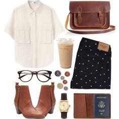 White button-down shirt, leather ankle boots, black jeans with white polka dots, leather messenger bag