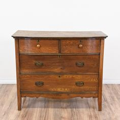 This antique dresser is featured in a solid wood with a glossy rustic oak finish. This small dresser is in great condition with 4 large drawers, curved base trim and a curved front. Eye catching storage piece great as a buffet! #traditional #dressers #shortdresser #sandiegovintage #vintagefurniture
