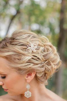 Bridal updo with small floral hairpin. Re-pin if you like. Via Inweddingdress.com #hairstyles