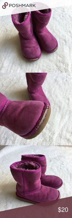 UGG Toddler Girls Magenta Boots size 11 Preowned authentic UGG Girls Magenta Boots size 11. Boots have signs of wear, specially in tips of shoe. Has holographic tag inside left boot. Please look at pictures for better reference. Thank you for looking and happy shopping! UGG Shoes Rain & Snow Boots