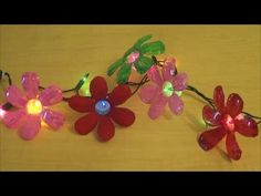 This tutorial shows how to make beautiful and colorful flowers out of recycled plastic water bottles.   if you paint only at the back side of the flower, it will get the glass like shiny look from the front view.  Best recycling idea..we can use them with lights, vases and as garlands. It would be great if you use these flower lights on outside pl...