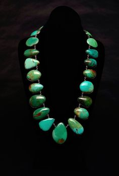 "Federico Artist: Federico Stones: Blue/Green Nevada Turquoise Metal: Sterling Silver Necklace Length: 26"" Stone Count: 23 Center Pendant Length: 2"" Center Pendant Width: 1 1/2"" What a fabulous blue/green Nevada Turquoise necklace by Federico!"