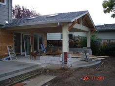 Gable roof patio cover attached to existing house with cedar beams ...