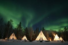 Northern Lights Over Teepees, Yellow Knife, Canada  These are spectacular and the teepees are so pretty in the dark.