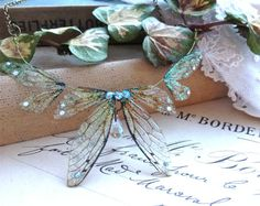 Beautiful delicate faerie winged necklace por UndertheIvy2 en Etsy