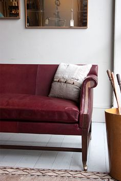A HOWE London Greyhound sofa covered in our Italian Hide Pallmelleto in the colour 'Siena'