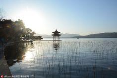 The West Lake in Hangzhou, Zhejiang province, under the sunrise