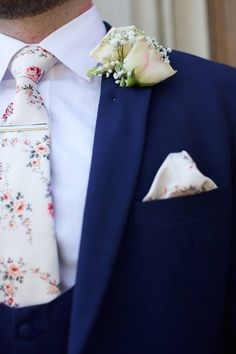 ivory vintage floral wedding tie with royal blue slim fit grooms suit.