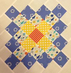 great granny block #4 Darling block.. using PKM blue.. my fav.  Goes so well with so many fabrics.