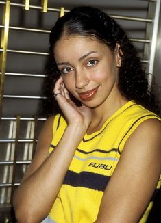 Mya wearing FUBU. Must be the late '90s.