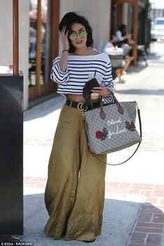 Loving it:Seemingly loving her new cut, the former Powerless actress was spotted grinning...