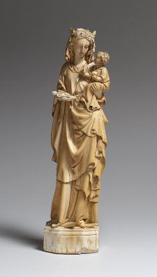 Statuette; ivory; Virgin standing with Child; Virgin's face not Medieval in character; traces of gilding and pigment.    Made in France    14th C