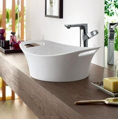 While they may have been inspired by the traditional dresser-top wash basin and pitcher, today's vessel sinks are nothing short of works of art. Check out 10 Vessel Sinks We Love!