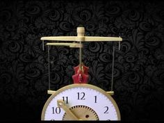 Clock 17 flying pendulum clock that uses a flying pendulum escapement mechanism. A small metal ball, string wraps around one brass post, then unwinds. Wooden Gear Clock, Wooden Gears, Clock Work, Pendulum Clock, Turn Blue, Clock Parts, The Struts, Clocks, Miniatures