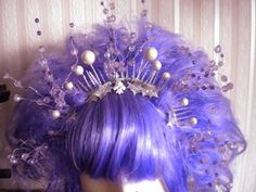 Glittering holly leaves, icicle points and pearlescant orbs make up the base of the built-in tiara. Silver-toned wires guide purple and lavender crystal-cut beads out in a delicate network to further frame the face.  The wire branches are adjustable and the bangs are carefully hand-streaked.  Fairy Wig with tiara - Lavender Snow Fairy *Sold - Auctioned to Rebuild Baltimore*