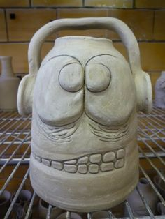 clay face jugs - use the top of a 20 oz bottle to make the shape, remove, and add a bottom