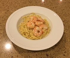 Lemon garlic pasta with shrimp cooked in the sauce. Shrimp removed for folks that don't want shrimp.