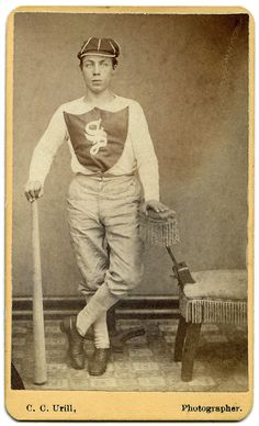 """""""Rare and wonderful CDV of an early 1870's baseball player leaning on his bat with one hand, and the chair with his other. He's wearing a fine baseball cap, and his shirt displays a shield with a large Old English """"S"""" upon it."""" C. C. Urill (American) 'Untitled [baseball player]' c. 1870s Carte de Visite 2.5"""" x 4.1875"""""""