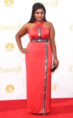 Bespoke Beauty from Mindy Kaling's Best Looks  Mindy went full bombshell in a custom Kenzo dress at the 2014 Primetime Emmy Awards.