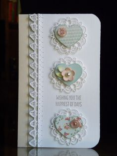 handmade card from paper wishes ... tall and narrow format .. punched hearts on littdie cut medallions .... luv the button adornment and use of real lace sewn on with machine zig zag stitch ...