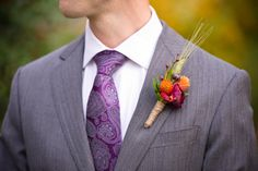 Autumn hues of magenta and orange combined with natural wheat create a stunning boutonniere for Justin's wedding at Audubon: Photography by Tina Jay.